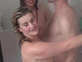 Wet amateur babes sharing pretentious cock in shower