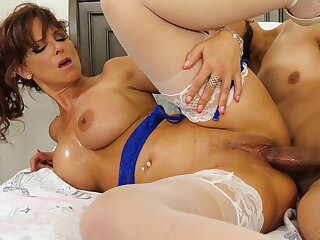 Seductive mature spins young meat helter-skelter her tight vag