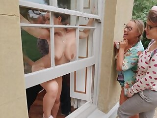 Two nerdy girls are watching a couple having intense sex