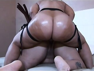 These two bitches' heavy oiled up booties quake when they fuck
